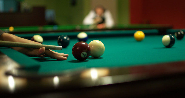 player setting up a shot billiards/pool standard equipment billiard balls