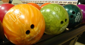 bowling balls on ball holder multiple colors of balls standard sizes for bowling balls