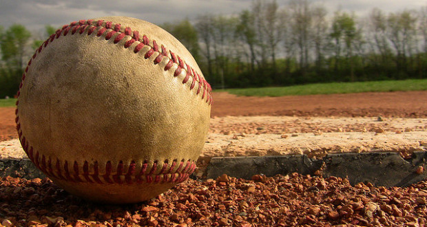 dirty baseball laying in the dirt in the diamond standard equipment for baseball is the ball