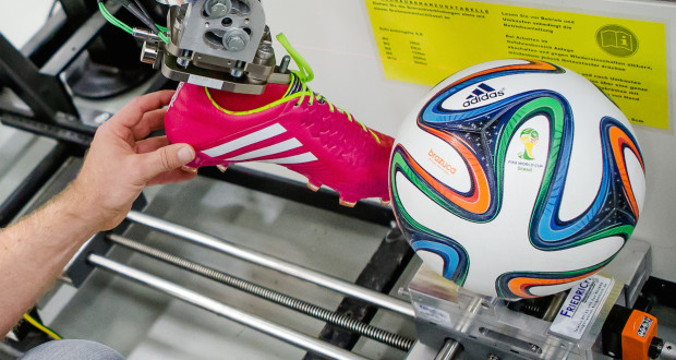 cleat being tested on 2014 FIFA soccer ball World cup standard football ball/soccer ball