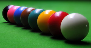 a row of snooker colored snooker balls white ball red ball orange ball green ball maroon ball blue ball pink ball black ball basic equipment for snooker ball