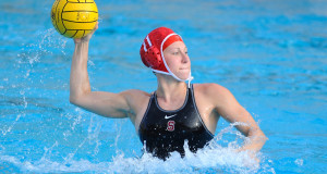 woman throwing regulated water polo ball with red cap and black sport bathing suit