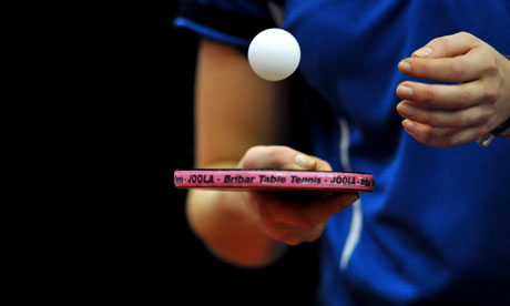 player in blue shirt bouncing white ping ping ball on ping pong paddle basic equipment for ping pong is NCTTA supplied balls also known as table tennis
