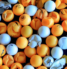 mixture of white and orange table tennis balls some are smashed and some are not basic equipment for table tennis ping ping balls