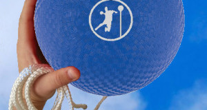 hand holding blue angle ball ball with angle ball logo in white on the side also holding a rope in same hand basic equipment for angle ball angle ball ball