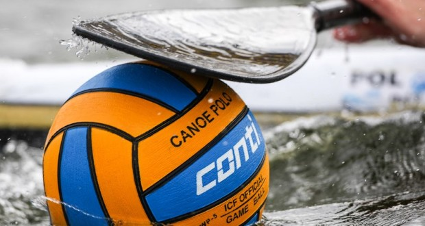 blue and orange canoe polo ball with paddle above basic equipment for canoe polo regulated ball