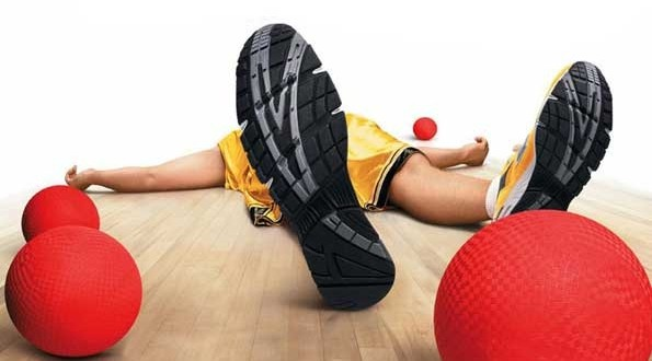 ad from dodgeball movie man laying on ground with view from under the soles of tennis shoes 4 red dodgeball balls basic equipment of dodgeball 4 red blocker balls 2 red stinger balls