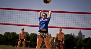 girl hitting medicine ball over volleyball net hooverball basic equipment medicine ball and net