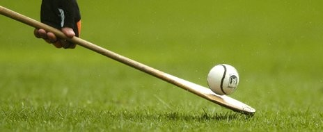 Hurling stick with ball on the end basic equipment