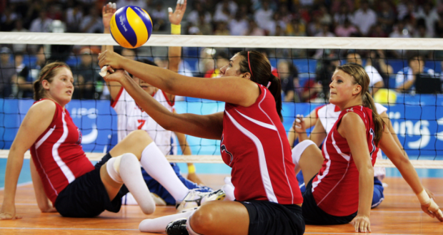 girls playing sitting volleyball this is a basic standard equipment with volleyball